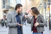 Angry Couple Arguing In The Middle Of A City Street poster