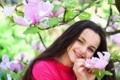 Perfect Spring Day. Pretty Girl Near Flowering Tree Enjoy Magnolia Blossom. Adorable Girl Smile In P poster