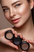Beautiful Young Girl With Natural Nude Make-up With Cosmetic In Hands. Beauty Face. poster
