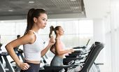 Women Running On Treadmill, Doing Cardio Exercise In Gym, Copy Space poster