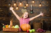 Kid Farmer With Harvest Wooden Background. Harvest Festival Concept. Child Little Girl Enjoy Farm Li poster