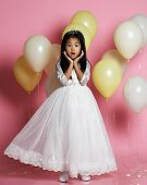 Surprised Asian Kid Girl With Balloons In Princess Dress With Tiara Princess Crown. Pink Background. poster