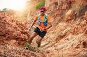 A Man Runner Of Trail . And Athletes Feet Wearing Sports Shoes For Trail Running In The Mountains poster