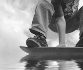 picture of hydroplanes  - extreme skateboarder hydroplaning    - JPG