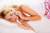 Sleepy Woman Answering A Phone Call