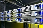 image of raid  - Rack mounted storage server hard drives in data center - JPG
