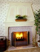 picture of cozy hearth  - Colonial style fireplace with fire in hearth - JPG