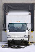 stock photo of loading dock  - cargo truck loading or unloading at docking bay - JPG