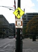 PEDESTRIAN AND ROUTE 66 SIGNS IN CHICAGO, UNITED STATES OF AMERICA