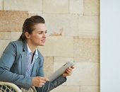 Thoughtful Business Woman Holding Tablet Pc And Looking On Copy