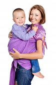 Happy Mother Carrying Baby Boy 3-4 Years Old In Sling Isolated On White Background