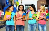 Four Beautiful College Girls Walking On The Street