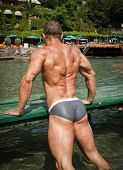 Handsome Young Bodybuilder's Back In The Sea Or Ocean