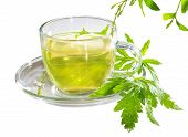 stock photo of home remedy  - Refreshing cup of lemon verbena tea with fresh leaves of the Verbena officinalus plant long used as a remedy for insomnia - JPG