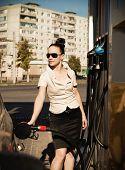 Young Beautiful Smiling Woman Fills Petrol Car