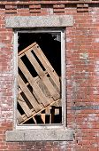 Window Of Boarded-up Abandoned Brick Building