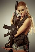 stock photo of bosom  - Portrait of a beautiful woman posing in a military style - JPG