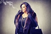 stock photo of snob  - fat woman smokes - JPG