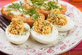 Deviled eggs with bread and mayonnaise, rich and tasty breakfast plate
