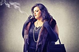 image of snob  - fat woman smokes - JPG