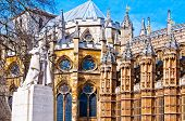 Statue of George V and Westminster Abbey, London