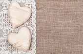 image of rude  - Burlap background with white lacy cloth and wooden hearts - JPG