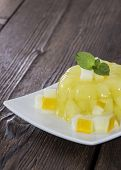 picture of jello  - Fresh made Honeydew Jello on wooden background - JPG