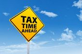 pic of irs  - Tax time concept with sign post under blue sky - JPG