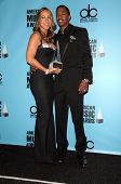 Mariah Carey and Nick Cannon  in the press room at the 2008 American Musica Awards. Nokia Theatre, Los Angeles, CA. 11-23-08