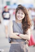 Beautiful Asian Teen Age Standing With Relaxing And Smiling To Camera With Eyes Contact