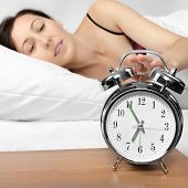 Brunette Woman Turning Off Her Alarm Clock