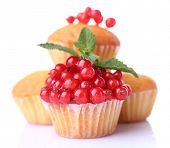 Tasty muffins with red currant isolated on white