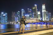 Singapore skyline and camera man