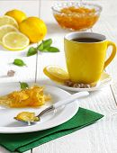foto of douceur  - Yellow jam and yellow cup of tea - JPG