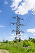 High-voltage Power Tower Over Blue Sky.