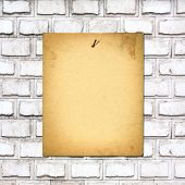 Old Paper Ad On Shabby Brick Wall Background