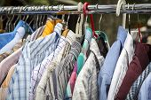 picture of thrift store  - clothes on a rack on a flea market.