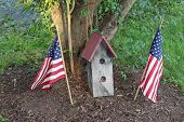 Birdhouse with flags