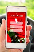 Hand Holding Mobile Phone With Florist Offer On Screen