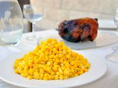 Dinner table with a chicken and corn