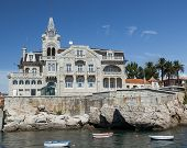 The building on the rocky embankment against a clear sky in Cascais, Portugal
