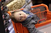 Boy In Shopping Trolley