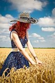 Happy woman in golden wheat in summer time. Serbia.
