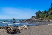 stock photo of klamath  - Wilson Creek beach Klamath California big rocks formation in water blue sky