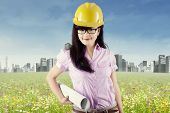 Pretty Engineer Holding Blueprint 1