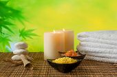 Spa Massage Border Background With Towel Stacked, Candle And Sea Salt