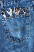 Four Wrenches In Blue Jean Pocket