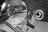 pic of trombone  - Trombone against the background of a cork cladded studio wall - JPG