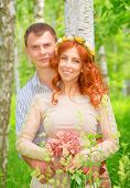 Portrait of cute cheerful couple hugging in the forest, happy wedding day, romantic feelings, new fa