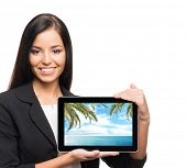 Young, confident, successful and beautiful business woman with the tablet computer showing the pictu